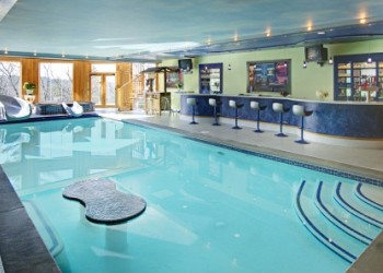 Indoor pool and hot tub with a slide  All About Indoor Swimming Pools, Hot Tubs, Spas and Jacuzzis